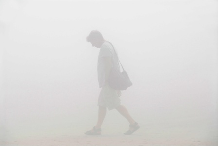 man walking in a fog